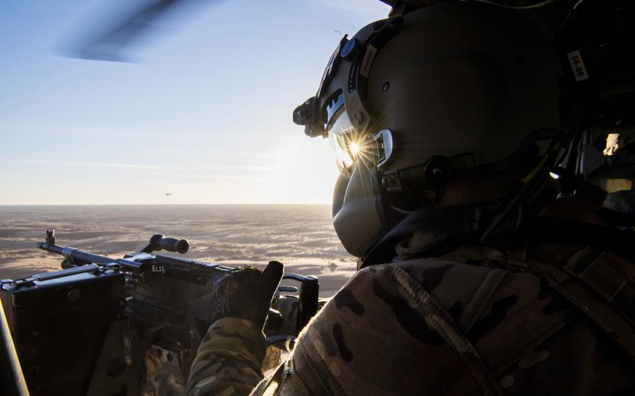 A U.S. Army flight medic with the 738th Air Expeditionary Advisory Group scans for threats Dec. 5, 2018, while participating in the NATO led Resolute Support mission in Afghanistan. The U.S.-led coalition in Afghanistan has stopped assessing whether the country?s districts are controlled by the government or insurgents.