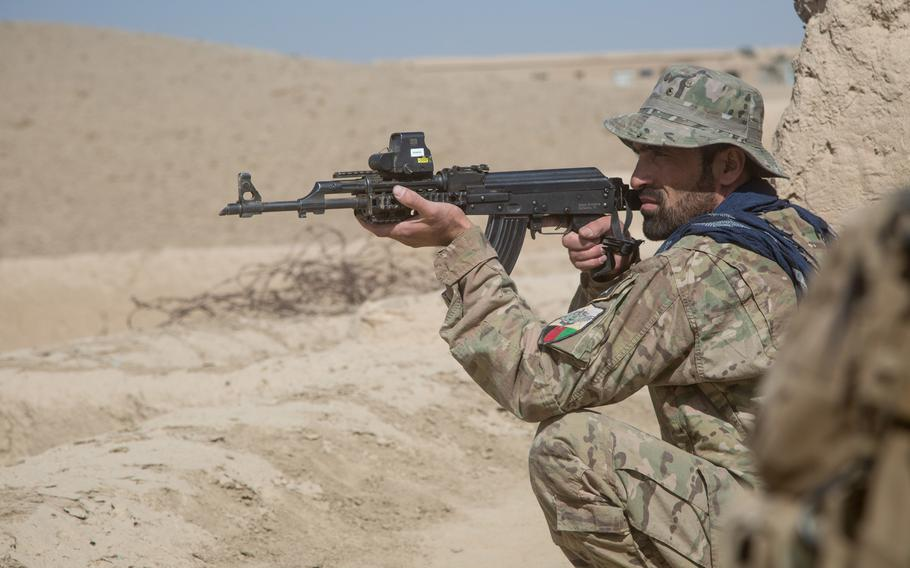 An Afghan special operator stands watch as Afghan Special Security Forces raid Taliban compounds in Baraki Barak district, Logar province in October 2018. The U.S.-led coalition in Afghanistan has stopped assessing whether the country?s districts are controlled by the government or insurgents.