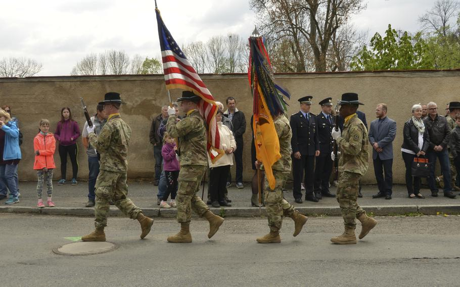 U.S. soldiers assigned to Eagle Troop, 2nd Squadron, 2nd Cavalry Regiment color guard march during the 74th anniversary of Operation Cowboy at the Hostoun Town Square, Houston, Czech Republic, on Tuesday, April 30, 2019.