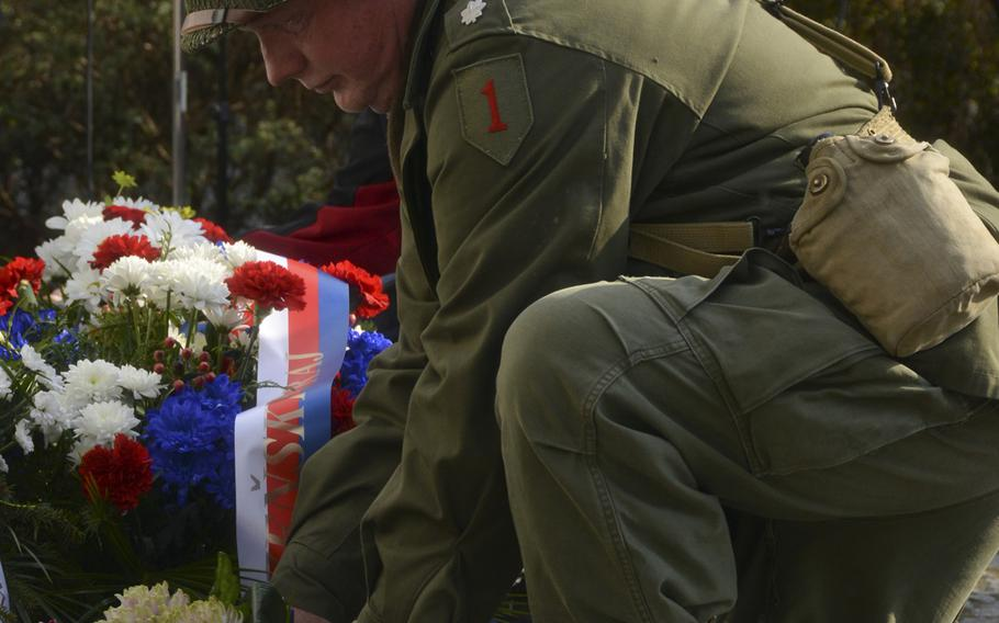 A Czech civilian lays down a wreath during the 74th anniversary of Operation Cowboy at Bela, Czech Republic, on Tuesday, April 30, 2019.