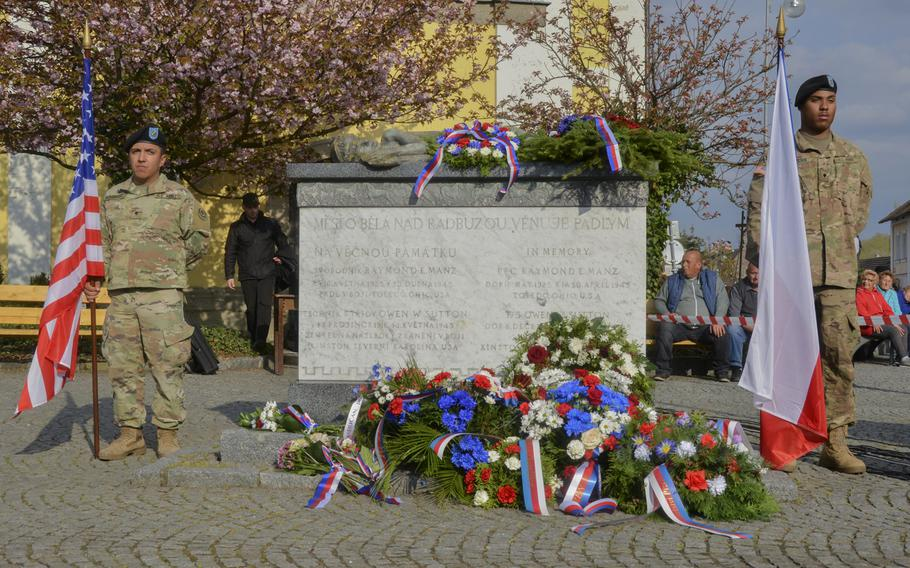 U.S. soldiers from the 2nd Cavalry Regiment  stand at attention with the American and Czech flags during the 74th anniversary of Operation Cowboy at the Bela Town Square, Bela, Czech Republic, on Tuesday, April 30, 2019.