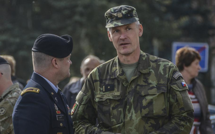 U.S. Army Maj. Kevin Hurtt, left, the Bilateral Affairs Officer at the U.S. Embassy in the Czech Republic, talks with Czech Army Maj. Jiri Stetina during the 74th anniversary of Operation Cowboy at the Bela Town Square, Bela, Czech Republic, on Tuesday, April 30, 2019.