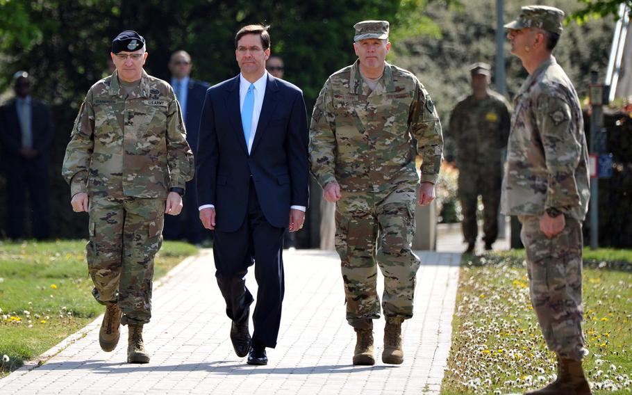 U.S. Army Gen. Curtis M. Scaparrotti, Army Secretary Mark T. Esper and Air Force Gen. Tod D. Wolters enter the parade grounds at the beginning of the U.S. European Command change of command ceremony in Stuttgart, Germany, Thursday, May 2, 2019. Wolters took over the command from Scaparrotti at the ceremony.
