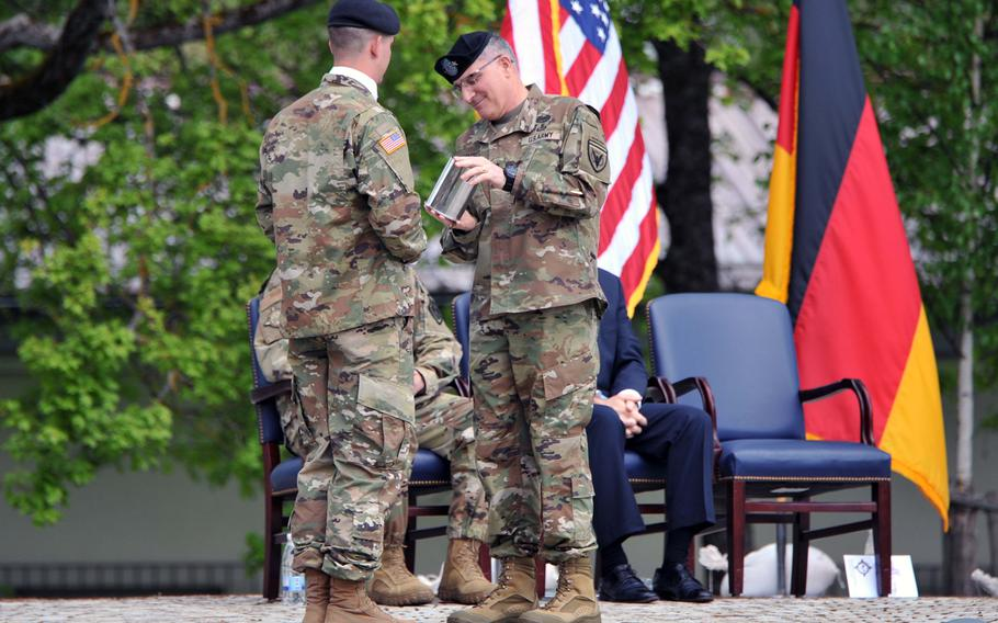 Outgoing U.S. EUCOM commander Gen. Curtis M. Scaparrotti receives a ceremonial shell casing from the salute battery at the U.S. European Command's change of command ceremony at Patch Barracks in Stuttgart, Germany, Thursday, May 2, 2019.