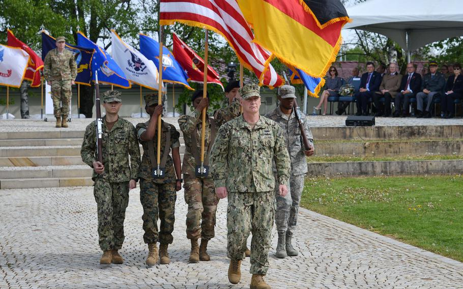 The U.S. European Command color guard marches off at the conclusion of the change of command ceremony at Patch Barracks in Stuttgart, Germany, Thursday, May 2, 2019. Watching the proceedings at left in the background is the new EUCOM commander Air Force Gen. Tod D. Wolters who took command from U.S. Army Gen. Curtis M. Scaparrotti.