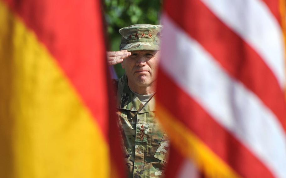 The incoming commander of  U.S. European Command, Air Force Gen. Tod D. Wolters, salutes during the playing of the German and American national anthems at the change of command ceremony at Patch Barracks in Stuttgart, Germany, Thursday, May 2, 2019.