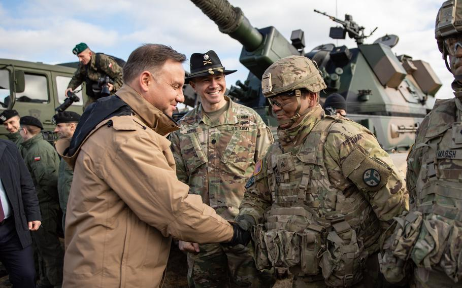 Polish president Andrzej Duda meets with soldiers assigned to the Tennessee Army National Guard?s 2nd Squadron, 278th Armored Cavalry Regiment's Task Force Raider, during a visit to Bemowo Piskie Training Area, Poland, March 6, 2019. The U.S. and Poland are negotiating an agreement that could mean stationing more American forces in the country.