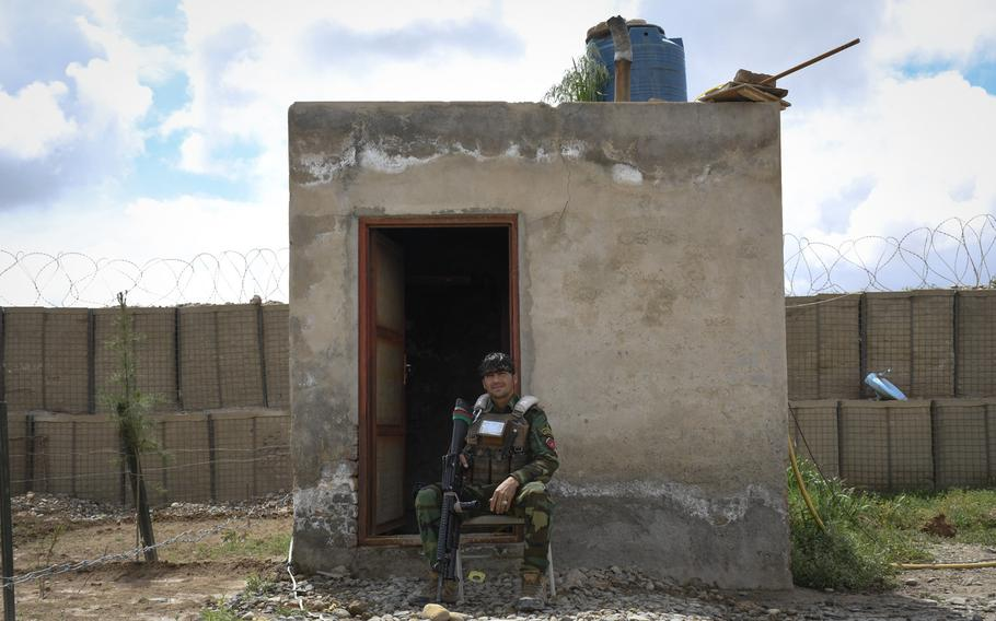 An Afghan soldier guards a remote outpost in Helmand province, the deadliest province in the country for Taliban attacks in 2018.