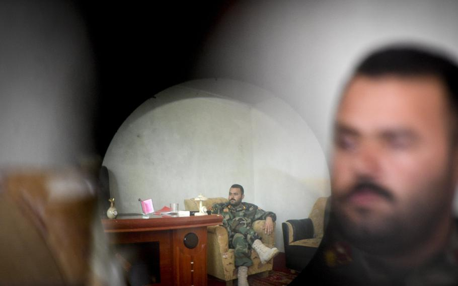 Photographed through a captured Taliban night-vision scope, Maj. Hedayat Rasoly, commander of the 3rd Kandak of the 215th Corps in Helmand province, said he faces constant threats from militant assassins.