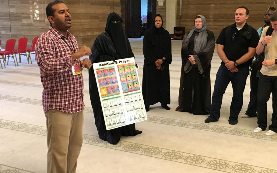 A guide answers questions for servicemembers at the Al-Fateh Mosque in Bahrain during a base indoctrination tour in August 2018.  Ramadan, the Muslim holy month, is set to begin May 6 and requires all expats in Bahrain to observe fasting laws during daylight hours.