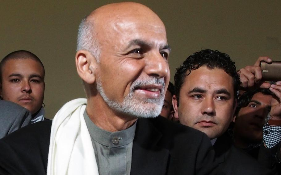 Afghan President Ashraf Ghani, seen here in a 2014 file photo, convened an Afghan council, known as the Loya Jirga, to hammer out a shared strategy for future negotiations with the Taliban.