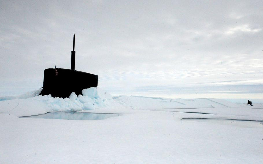 The fast attack submarine USS Seawolf is submerged after surfacing through the arctic ice July 30, 2015. U.S. military officials will hold talks this week in Greenland about security in the arctic. A top concern is China, which is investing heavily in the high north and beyond in Europe.