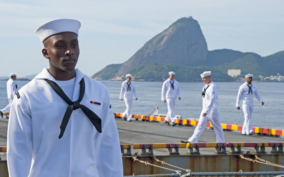 Sailors man the rails aboard the amphibious assault ship USS Wasp as the ship prepares to moor in Rio de Janeiro in 2017. President Donald Trump said he will grant special military status to Brazil, making it a ''major non-NATO ally'' in a move to boost cooperation. In the background is Rio's famed Sugarloaf Mountain.