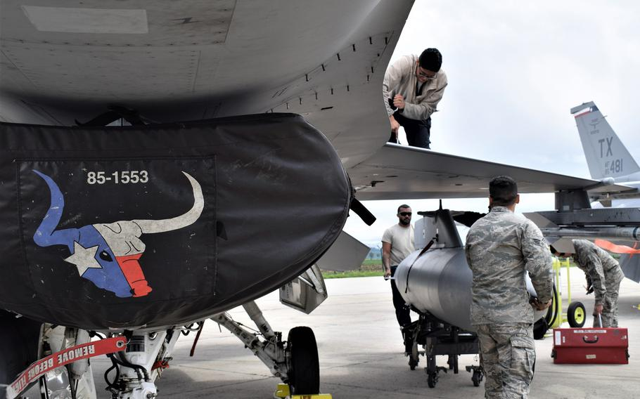 Airmen assigned to the 301st Fighter Wing, Naval Air Station Joint Reserve Base Fort Worth, Texas, maintain F-16C Fighting Falcons at Campia Turzii, Romania, May 6, 2019.