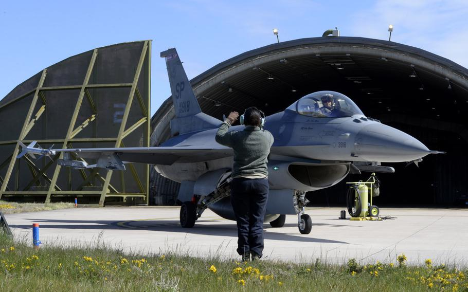 U.S. Air Force Staff Sgt. Reina Baker, 52nd Aircraft Maintenance Squadron, directs the departure of an F-16 Fighting Falcon flown by Maj. Kevin Bunten, 480th Fighter Squadron, before a low-level training sortie at RAF Lossiemouth, Scotland, May 7, 2019.
