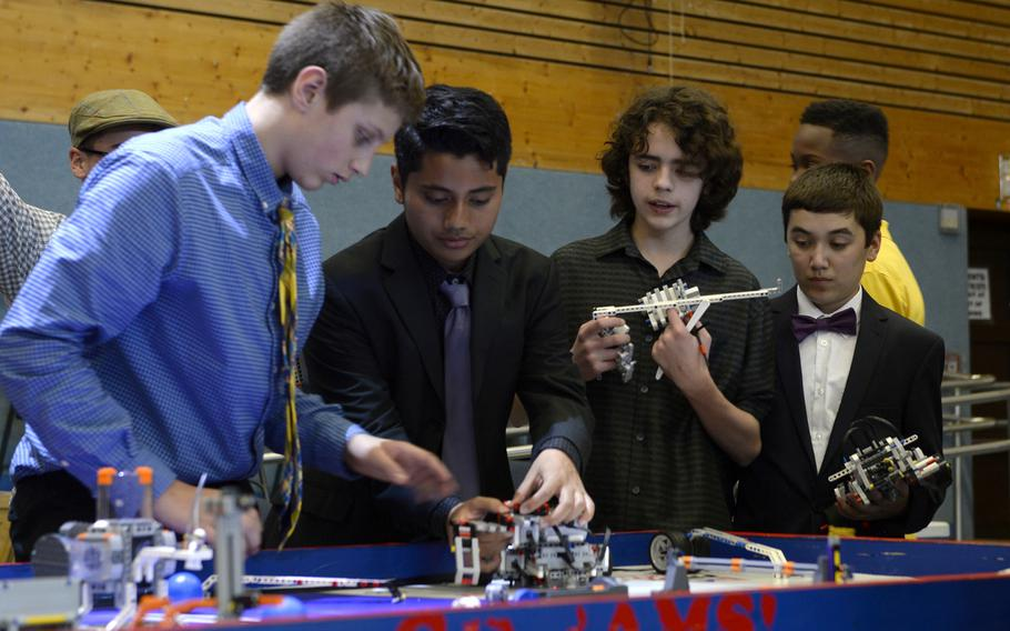 Ramstein Middle School students prepare their robots for the table demonstration during the robotics and music exhibition at Ramstein Middle School, Germany, May 9, 2019.