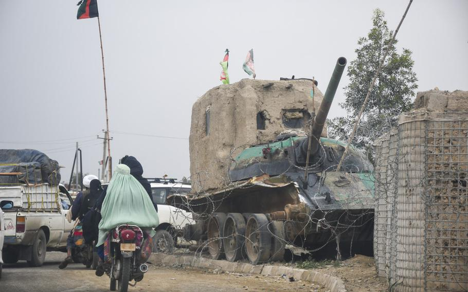 A small checkpoint built around the wreck of a Soviet tank on the outskirts of Lashkar Gah, in Helmand province, April 14, 2019.  Almost half of Afghan troops killed or wounded last year were defending small checkpoints, sometimes manned by as few as four or five soldiers.