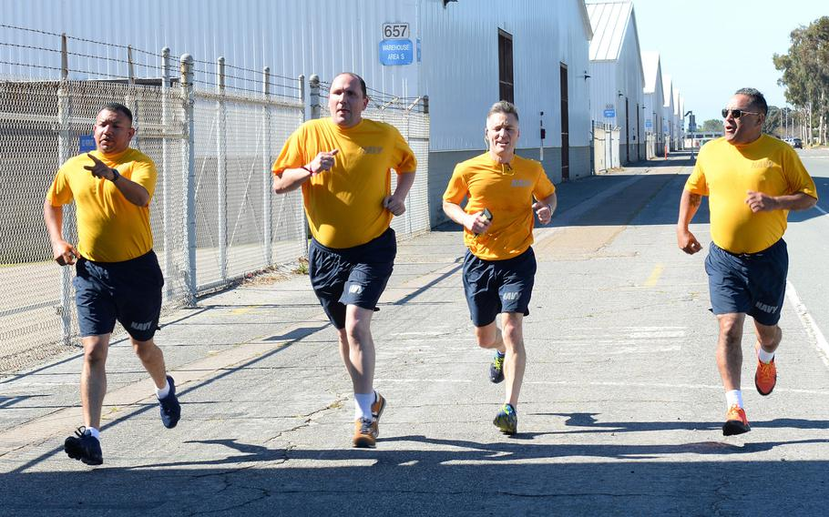 Sailors assigned to Navy Operational Support Center North Island finish a 1.5 mile run during the spring physical readiness test April 7, 2019, on Naval Air Station North Island, San Diego, Calif. The Navy has issued guidelines to halt physical training of sailors who show unusual distress and let them make up the training another day.