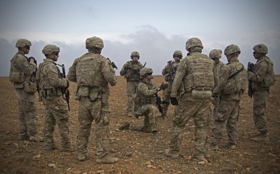 U.S. soldiers gather for a brief during a combined joint patrol rehearsal in Manbij, Syria, Nov. 7, 2018. U.S. military officials have said there is an elevated threat level facing U.S. troops deployed in Iraq and Syria, primarily from Iranian-controlled Shiite militias.