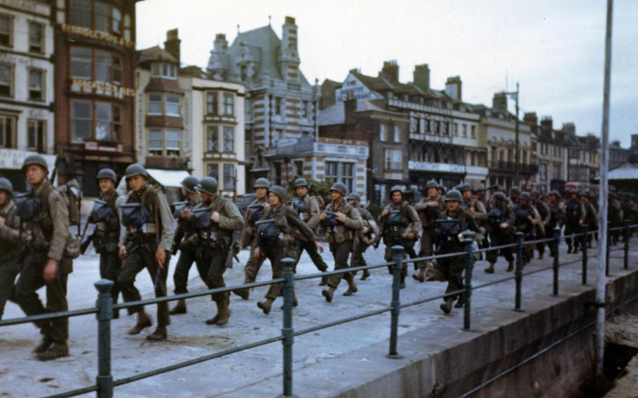 These American troops are marching through the streets of Weymouth, England, in June 1944, on their way to the docks where they will be loaded into landing craft for the big assault.