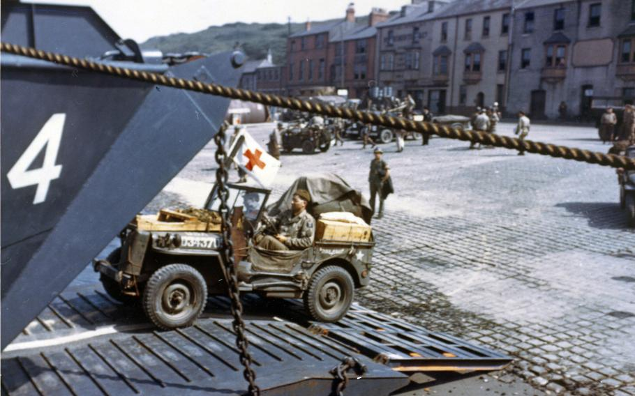 Jeeps being driven into the open doors of a tank landing craft in Portland, England, in preparation for D-Day in June 1944.