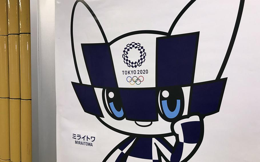A poster advertising the 2020 Summer Olympics is seen inside a Tokyo subway station in 2019.
