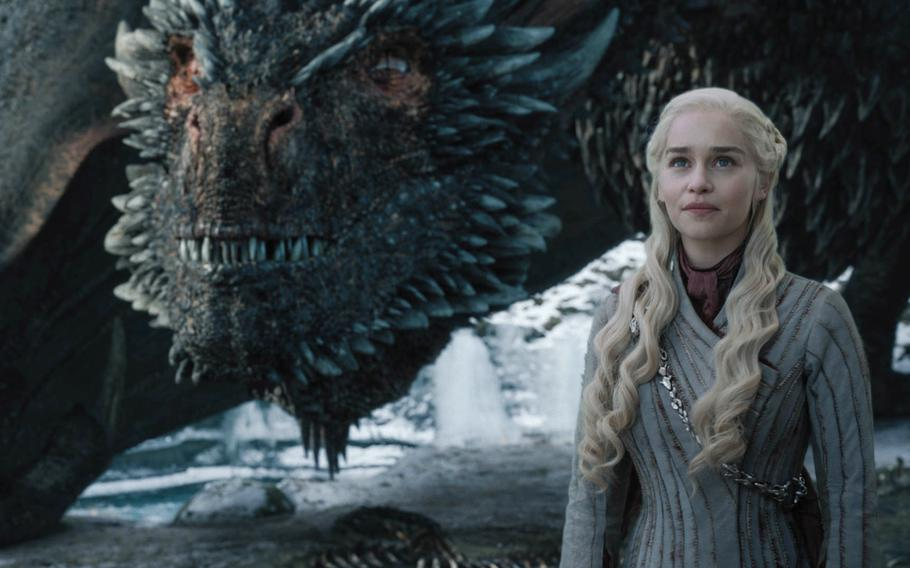 Emilia Clarke as Daenerys Targaryen in HBO's Game of Thrones next to her dragon, Drogon. Soldiers and Marines who spoke with Stars and Stripes had different opinions in how dragons should have been used tactically in the series.