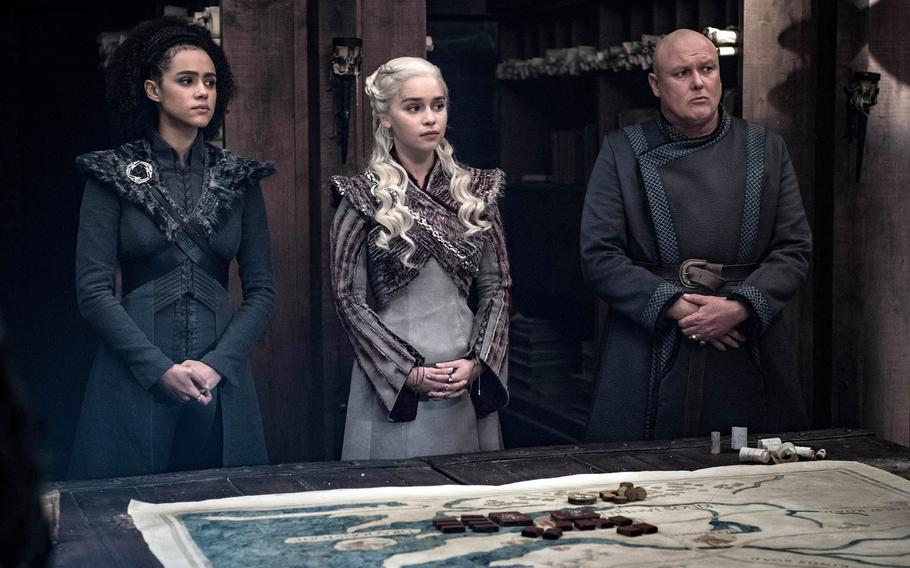 Missandei, left, Daenerys Targaryen and Lord Varys strategize during HBO's ''Game of Thrones.''