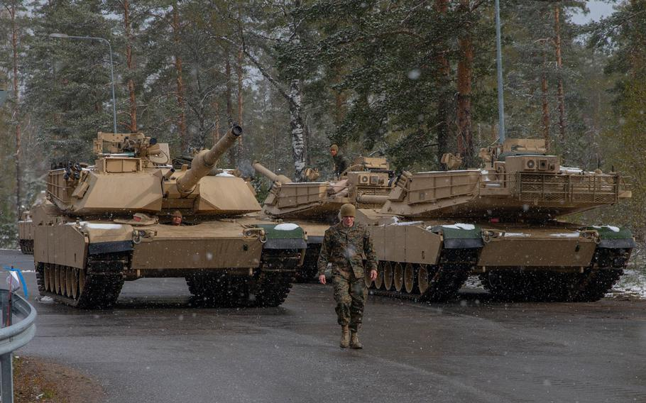 Lance Cpl. Zackary Long, a tank crewman with 2nd Tank Battalion, 2nd Marine Division, II Marine Expeditionary Force, guides a M1A1 Abrams tank during exercise Arrow 2019 at Niinisalo Garrison, Finland, on May 4, 2019.