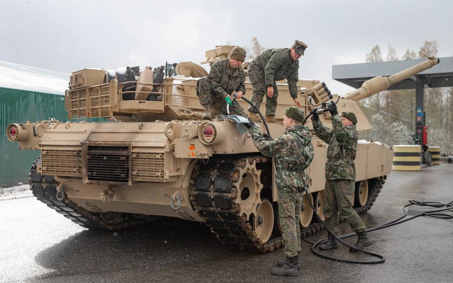 Marines with 2nd Tank Battalion, 2nd Marine Division, receive fuel from Finnish soldiers with 2nd Logistics Regiment, Logistics Command, during exercise Arrow 2019 at Niinisalo Garrison, Finland, May 4, 2019.
