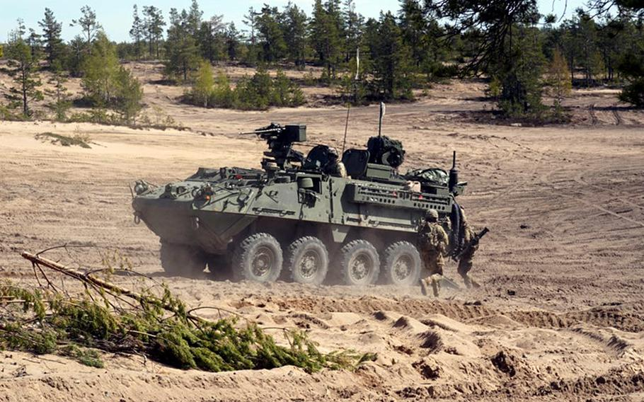 A U.S. Army Stryker Infantry Carrier Vehicle crosses the terrain during Exercise Arrow in the Pojankangas Training Area in Finland.