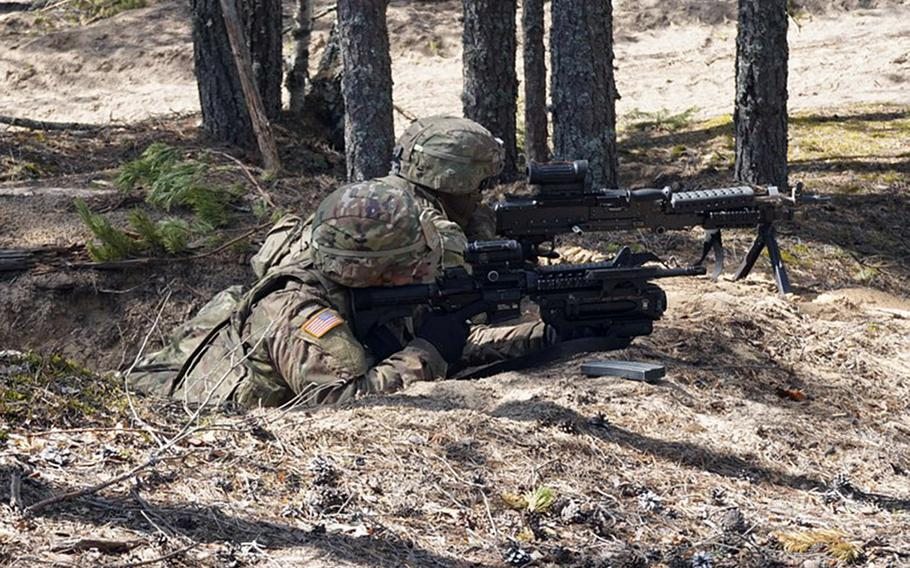 Soldiers with the U.S. Army's 2nd Cavalry Regiment provide cover during Exercise Arrow in the Pojankangas Training Area in Finland.