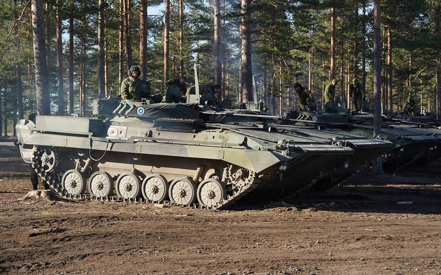 Finnish armored vehicles maneuver during Exercise Arrow in the Pojankangas Training Area in Finland.