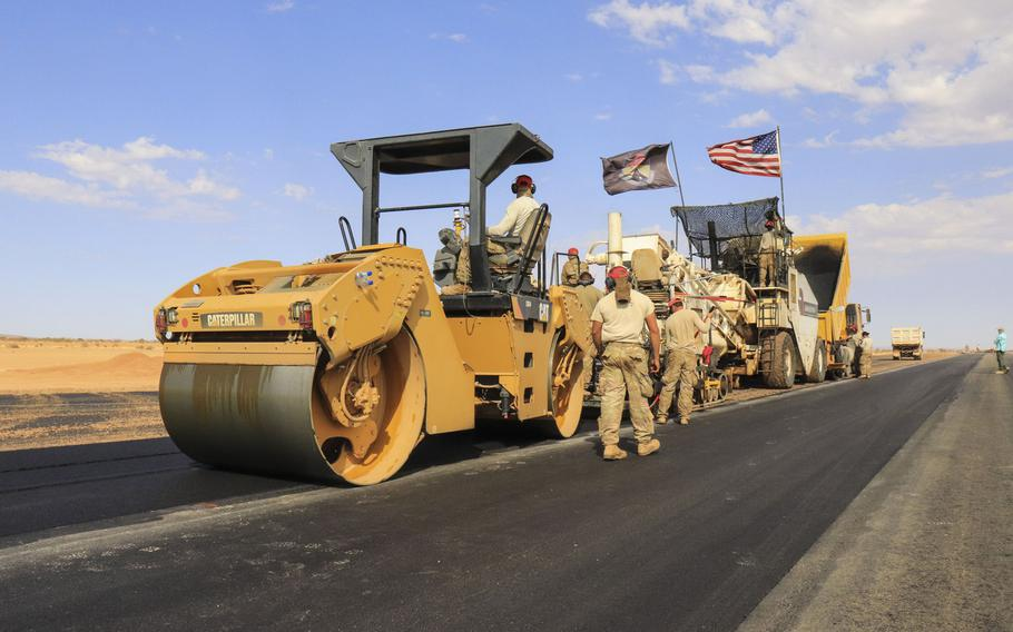 Airmen assigned to the 31st Expeditionary Squadron use a steamroller to level asphalt while paving a flight line on Nigerien Air Base 201, Niger, in December 2018.  The U.S. military?s new base is scheduled to open this summer.