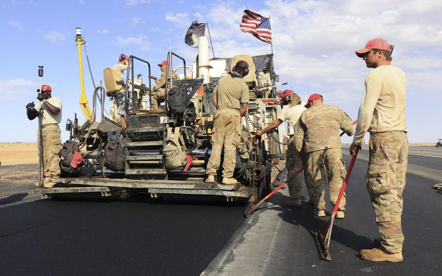 Airmen from the 31st Expeditionary Squadron use a steamroller to level asphalt while paving a flight line on Nigerien Air Base 201, Niger, in December 2018.  The U.S. military?s new base is scheduled to open this summer.