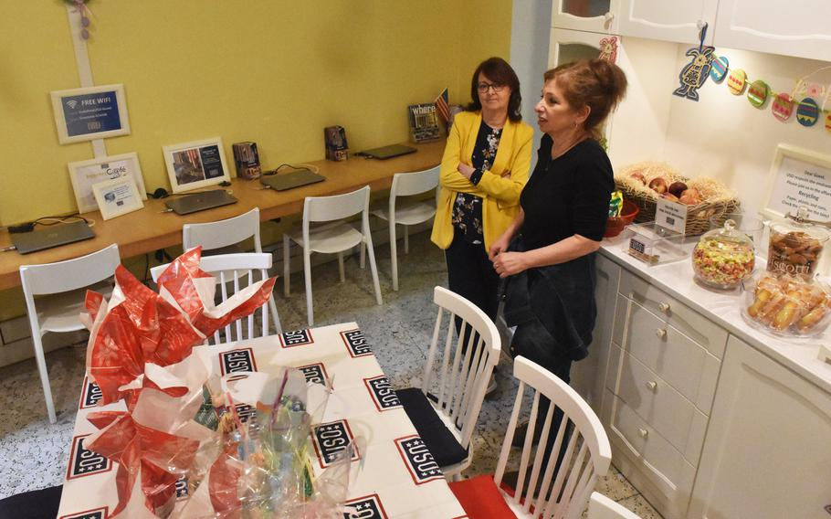 Donna Cafaro, right, a program coordinator, chats with visitor Sandra Cenci on April 25, 2019, at the USO Rome center, which will close on June 3, 2019, after more than 70 years.