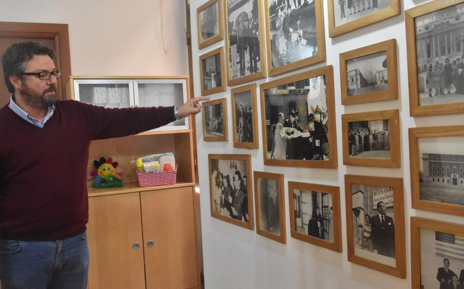 Cristiano Formicola, a program coordinator, points to a photo of Pope Pius X11 on April 25, 2019, at the USO Rome center. The pope and Gen. Mark Clark, who led U.S. ground forces into Rome in 1944, agreed to start a club that later became Europe's first USO center.