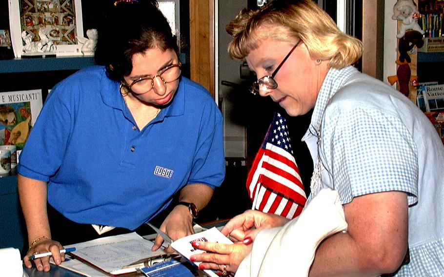 Donna Cafaro, left, gives directions to a customer at the Rome USO in October 1998.