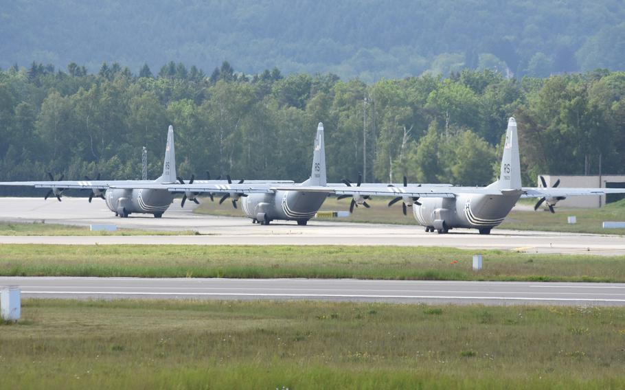 Three C-130J from the 37th Airlift Squadron at Ramstein Air Base, Germany, taxi down the runway Wednesday, May 29, 2019, prior to taking off for Normandy, France. Four planes and about 40 personnel from the squadron will participate in events next week marking the 75th anniversary of D-Day.