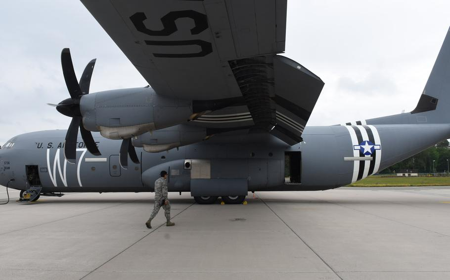 """A C-130J from Ramstein Air Base, Germany, sports a 'W7' and """"invasion stripes,"""" a vintage paint scheme to commemorate the 75th anniversary of the D-Day invasion in Normandy, France. C-47 aircraft from the former 37th Troop Carrier Squadron were painted with similar markings when dropping paratroopers in Normandy on D-Day."""