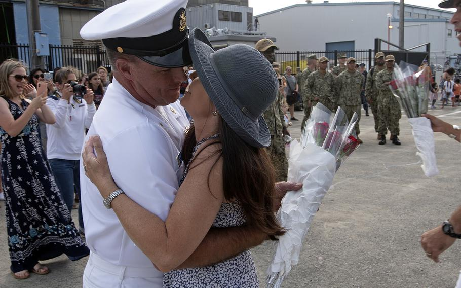USS Blue Ridge Command Master Chief James Grant kisses his wife after a four-month patrol aboard the U.S. 7th Fleet flagship at Yokosuka Naval Base, Japan, May 29, 2019.
