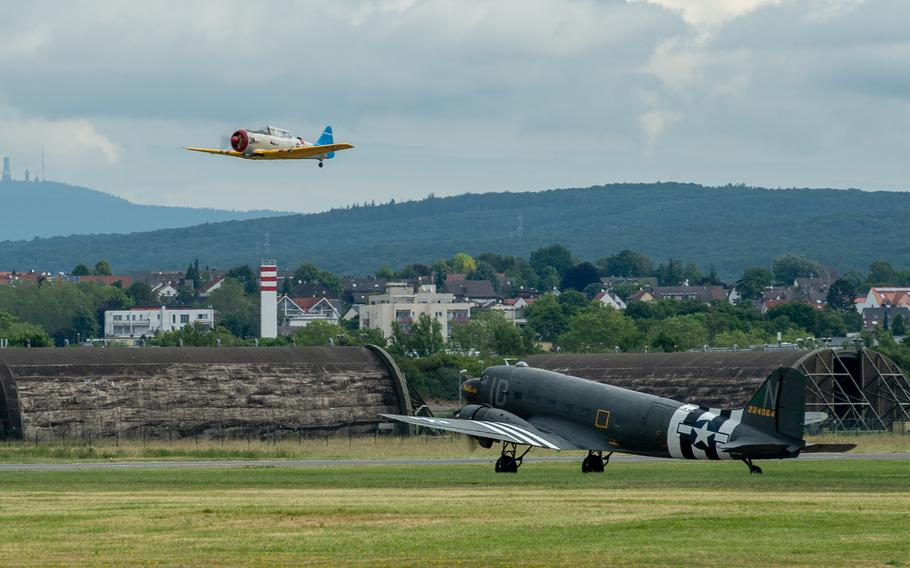 A T-6 Texan takes off as a C-47 Skytrain waits during the 70th anniversary commemoration of the end of the Berlin Airlift at Clay Kaserne airfield, Monday, June 10, 2019.