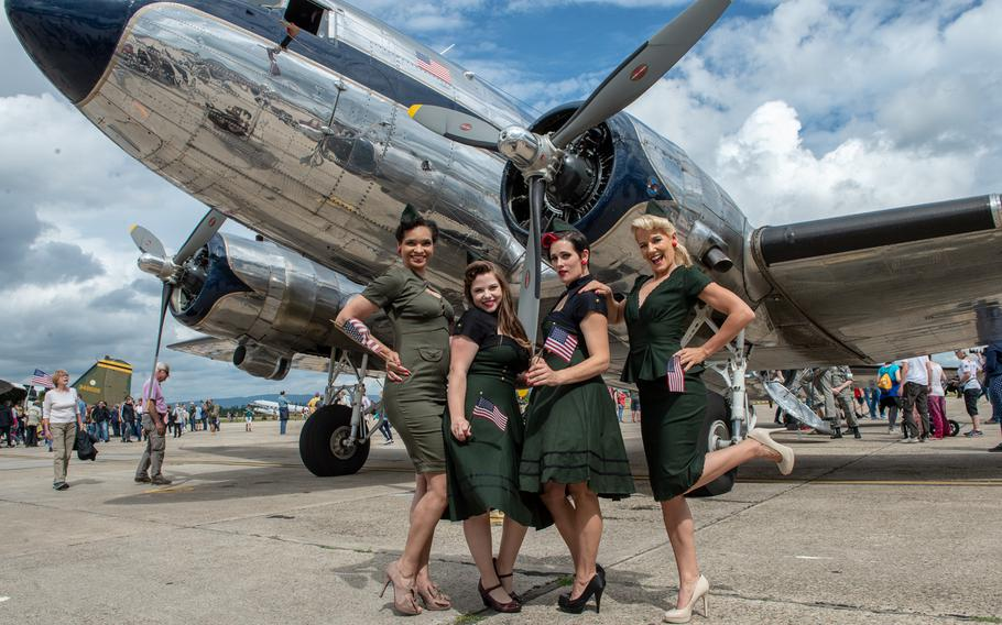 Army spouses pose as pinup girls for the crowd during the 70th anniversary commemoration of the end of the Berlin Airlift at Clay Kaserne airfield, Monday, June 10, 2019.