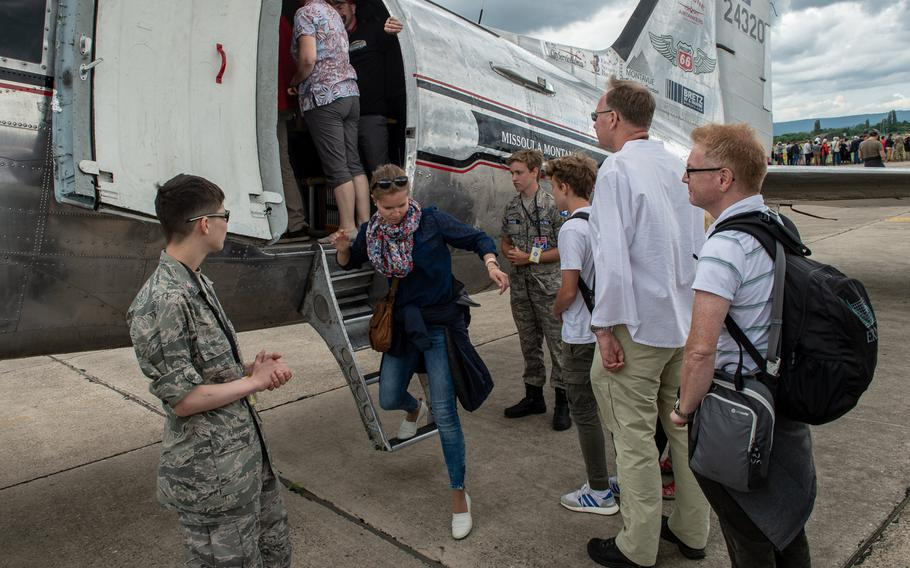 Spectators wait to board the C-47 known as Miss Montana as it sits on display during the 70th anniversary commemoration of the end of the Berlin Airlift at Clay Kaserne airfield, Monday, June 10, 2019.