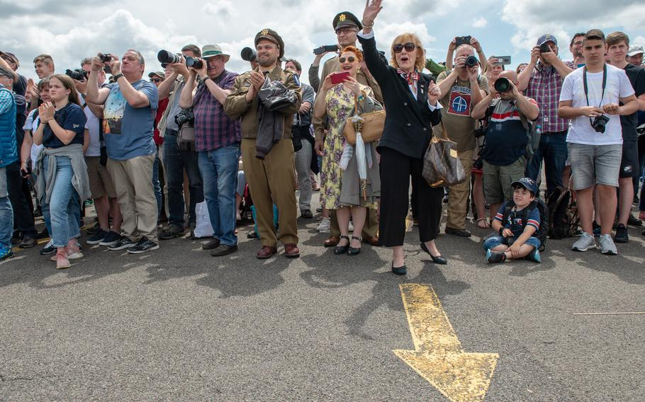 Vera Mitschrich, a Berlin Airlift witness, waves as retired Col. Gail Halvorsen, the candy bomber, arrives at the 70th anniversary commemoration of the end of the Berlin Airlift at Clay Kaserne airfield, Monday, June 10, 2019.