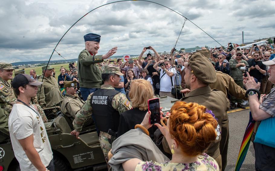 Retired U.S. Col. Gail Halvorsen greets spectators after arriving at the 70th anniversary commemoration of the end of the Berlin Airlift at Clay Kaserne airfield, Monday, June 10, 2019.