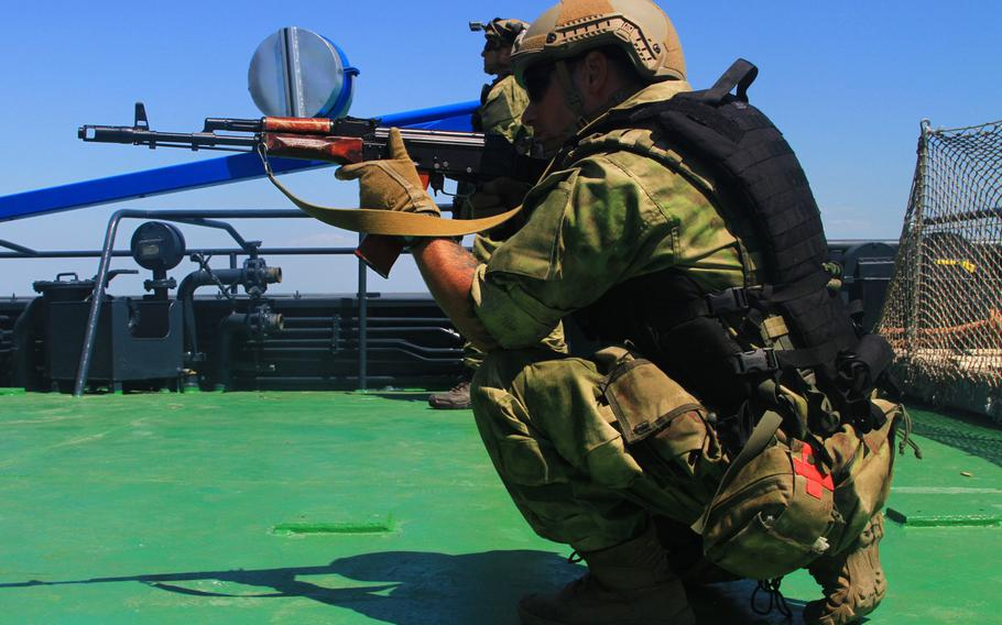 During boarding training in the Black Sea, a Ukrainian special operations soldier provides security alongside U.S. special operators during exercise Sea Breeze in 2017. The U.S. is increasing military aid to Ukraine, with a focus on helping beef up the country's navy and marines.