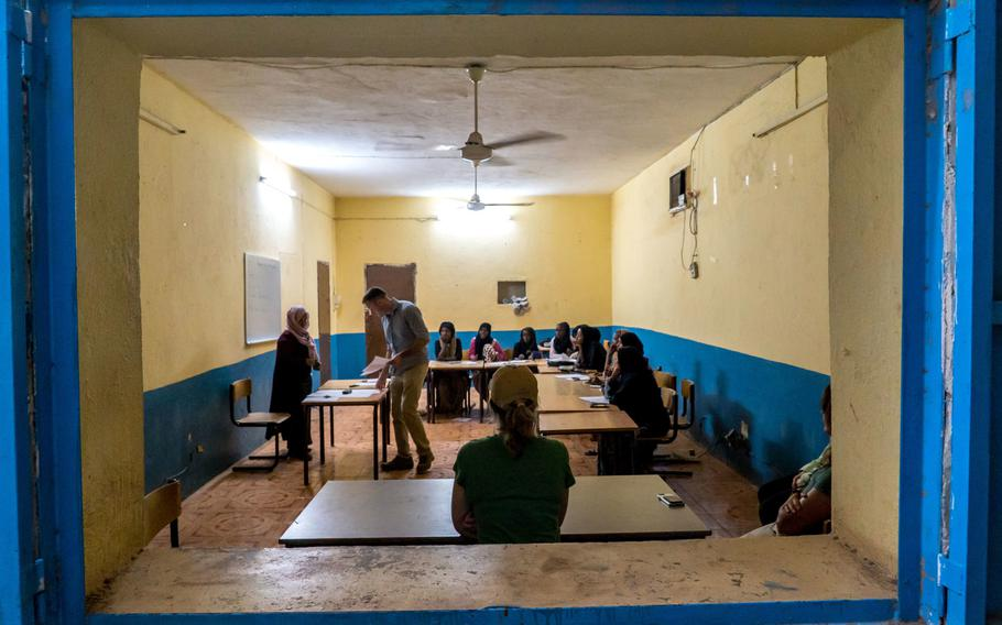 U.S. Army Capt. Bryan Bintliff, deployed in support of Combined Joint Task Force - Horn of Africa, participates in an English discussion group  with young Djiboutians in Dikhil, Djibouti, Jan. 22, 2019.