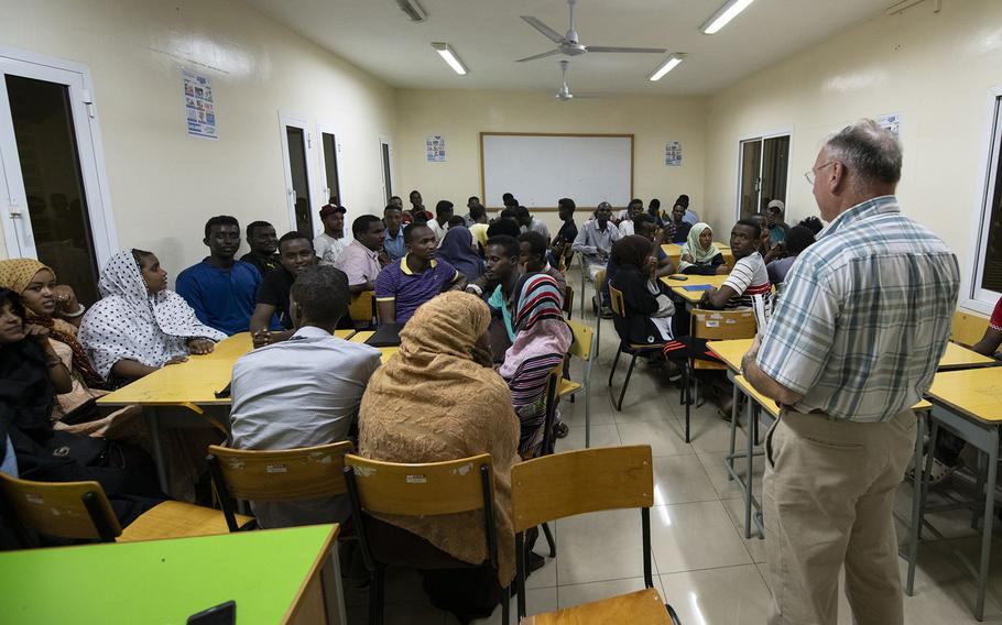 U.S. Army Capt. Michael Volk, a civil affairs officer, gives opening remarks during the first-ever English discussion group held in the neighborhood of Balbala in the capital of Djibouti, on Nov. 29, 2018. More than 40 Djiboutians attended the discussion group.