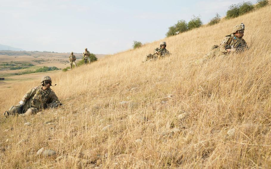 U.S. soldiers, assigned to 2nd Squadron, 2nd Cavalry Regiment, stop to pull security as they advance to the simulated enemy targets for the live-fire exercise during Agile Spirit 19 near Tbilisi, Georgia, July 29, 2019.
